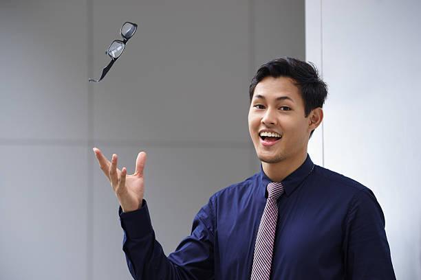 Asiatique Homme d'affaires lancer Lunettes de vue lunettes Ophtalmologie - Photo