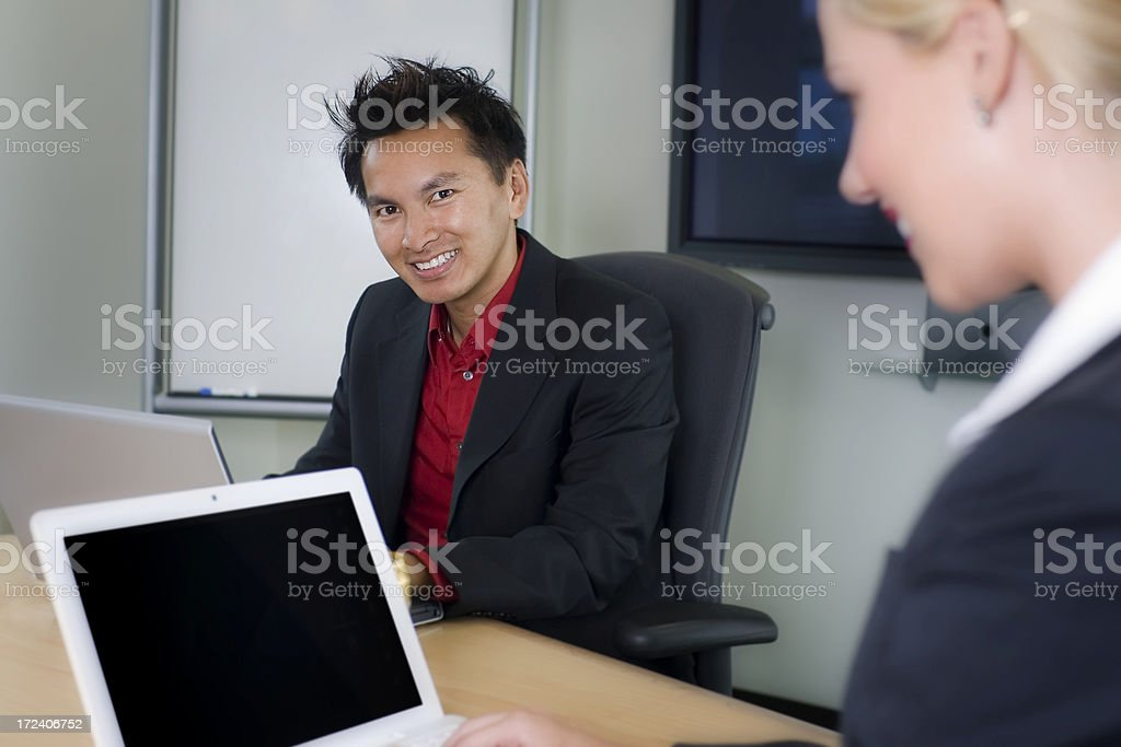 Asian Business Man with Coworker Using Laptops in Meeting Room royalty-free stock photo