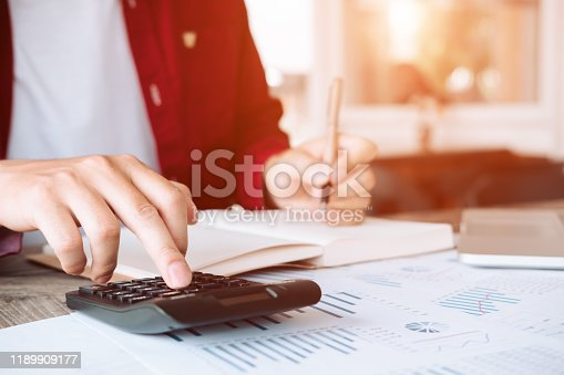 950986656istockphoto asian business man working with new startup project  pointing graph discussion and analysis data charts and graphs and using a calculator to calculate  numbers.Business finances and accounting concept 1189909177