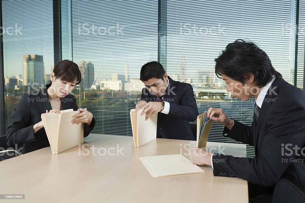 Asian Business Office Staff Meeting, Searching for Lost File Papers royalty-free stock photo