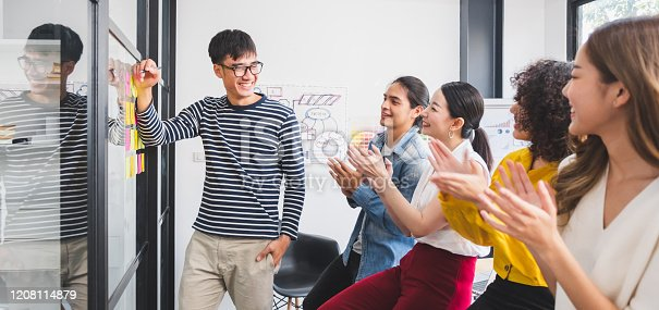 1031237974 istock photo Asian business people clapping hands/applause  while meeting for success in modern office, casual clothing 1208114879