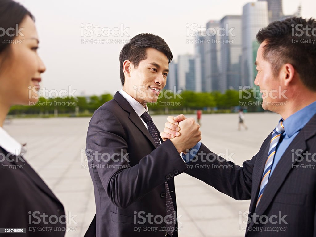 Asian Business People Greeting Each Other Stock Photo More