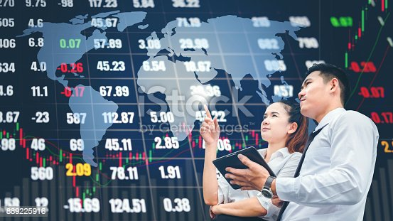 865596974istockphoto Asian business people meeting and working on digital tablet Stock market exchange information and Trading graph background 889225916