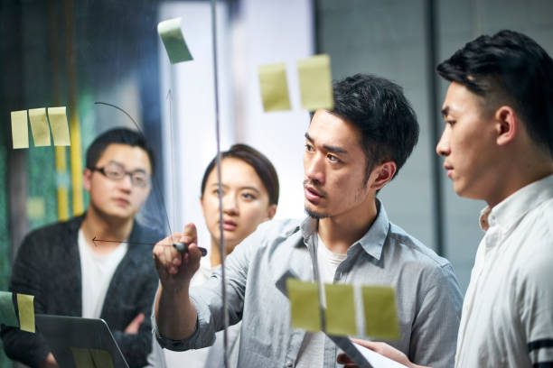asian business people meeting in office stock photo