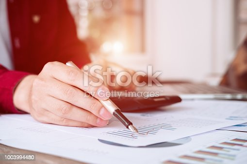 927401824 istock photo Asian business people meeting with new startup project pointing graph discussion and analysis data charts and graphs.Business finances and accounting concept 1003994480