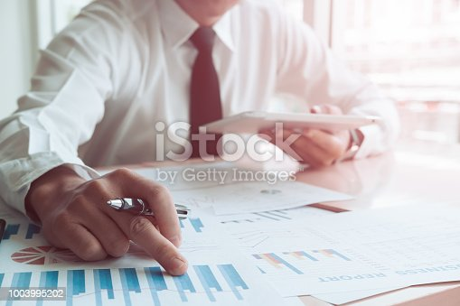 927401824 istock photo Asian business people meeting with new startup project pointing graph discussion and analysis data charts and graphs.Business finances and accounting concept 1003995202