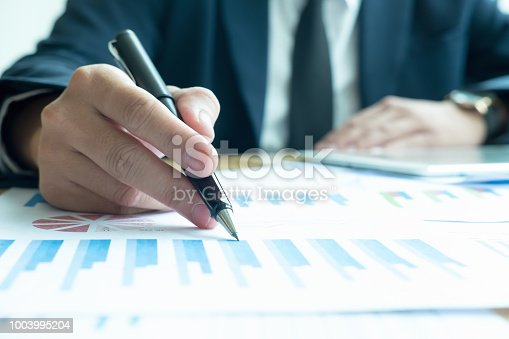 927401824 istock photo Asian business people meeting with new startup project pointing graph discussion and analysis data charts and graphs.Business finances and accounting concept 1003995204
