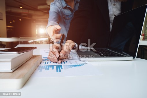 927401824 istock photo Asian business people meeting with new startup project pointing graph discussion and analysis data charts and graphs.Business finances and accounting concept 1049320824