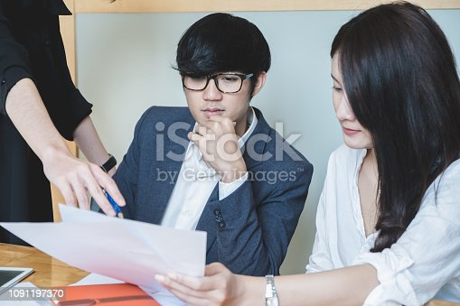 1127866562 istock photo Asian business people meeting with new startup project pointing graph discussion and analysis data charts and graphs.Business finances and accounting concept 1091197370
