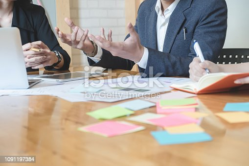927401824 istock photo Asian business people meeting with new startup project pointing graph discussion and analysis data charts and graphs.Business finances and accounting concept 1091197384
