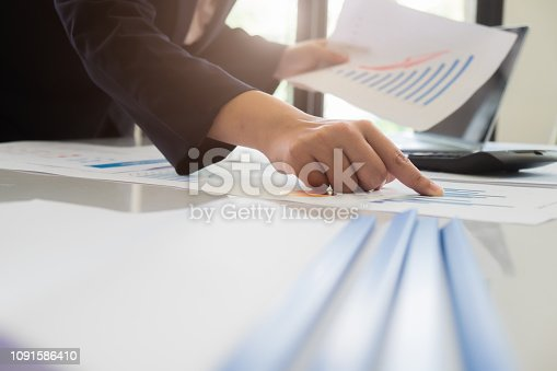 927401824 istock photo Asian business people meeting with new startup project pointing graph discussion and analysis data charts and graphs.Business finances and accounting concept 1091586410