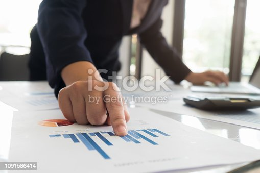 927401824 istock photo Asian business people meeting with new startup project pointing graph discussion and analysis data charts and graphs.Business finances and accounting concept 1091586414