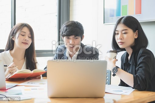 927401824 istock photo Asian business people meeting with new startup project pointing graph discussion and analysis data charts and graphs.Business finances and accounting concept 964976360
