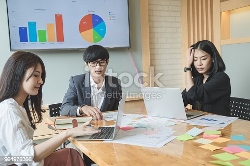 927401824 istock photo Asian business people meeting with new startup project pointing graph discussion and analysis data charts and graphs.Business finances and accounting concept 964976366