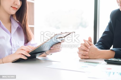 927401824 istock photo Asian business people meeting with new startup project pointing graph discussion and analysis data charts and graphs.Business finances and accounting concept 966260992