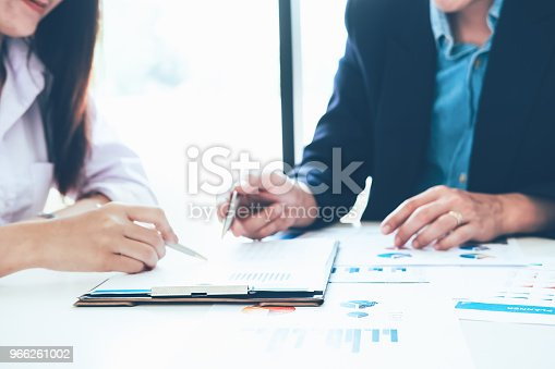 927401824 istock photo Asian business people meeting with new startup project pointing graph discussion and analysis data charts and graphs.Business finances and accounting concept 966261002