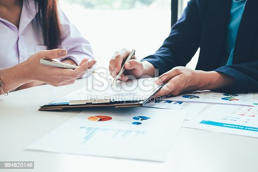 927401824 istock photo Asian business people meeting with new startup project pointing graph discussion and analysis data charts and graphs.Business finances and accounting concept 994820146