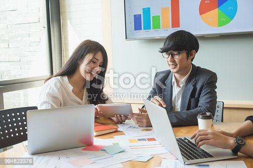 927401824 istock photo Asian business people meeting with new startup project pointing graph discussion and analysis data charts and graphs.Business finances and accounting concept 994823376
