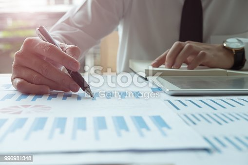 927401824 istock photo Asian business people meeting with new startup project pointing graph discussion and analysis data charts and graphs.Business finances and accounting concept 996981348