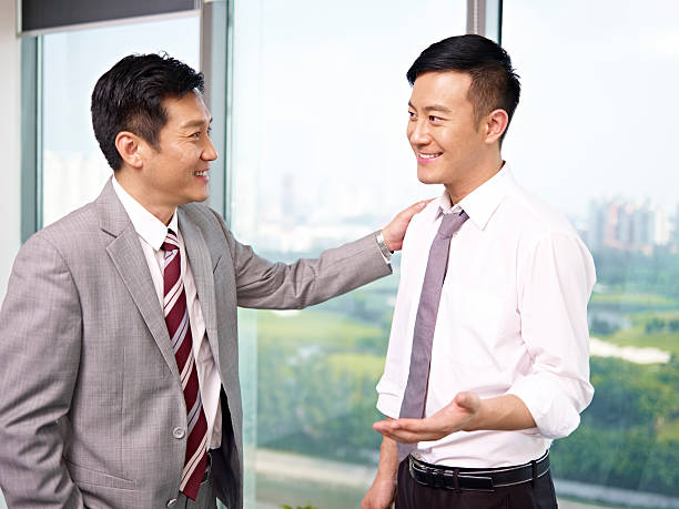アジアビジネスの人々 - ビジネスフォーマル ストックフォトと画像