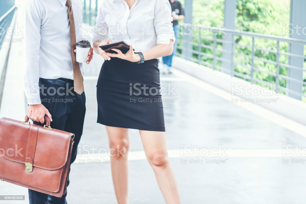 Asian Business people walking and talking outside office. - foto stock