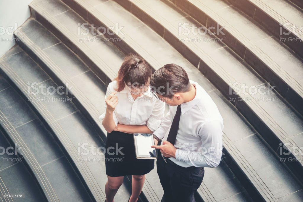 Asian Business people walking and talking outside office - foto stock
