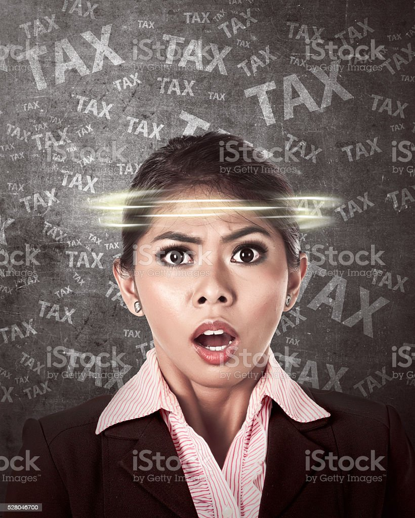 Asian business person thinking hard about tax stock photo