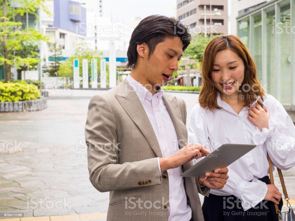 Asian Business persons checking an information from tablet PC. stock photo