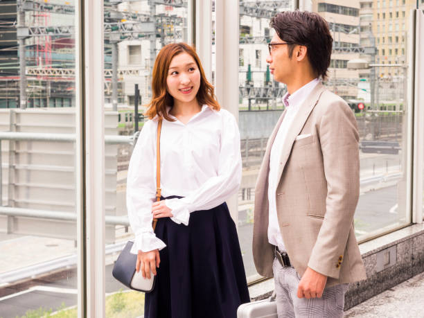 Asian business persons talking on the street. stock photo