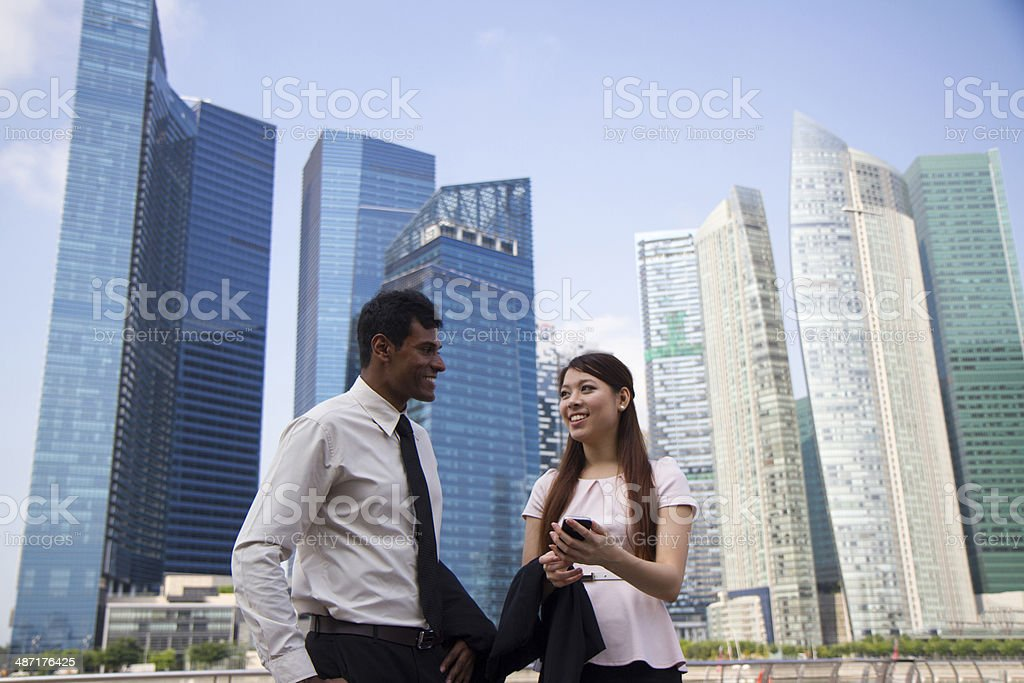 Asian Business Team in discussion stock photo
