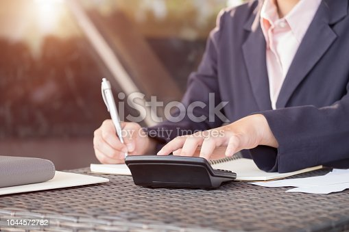 860389678istockphoto Asian business woman analyze and discuss the situation on the marketing data online and calculate about cost in the meeting room. Business finances and accounting 1044572782
