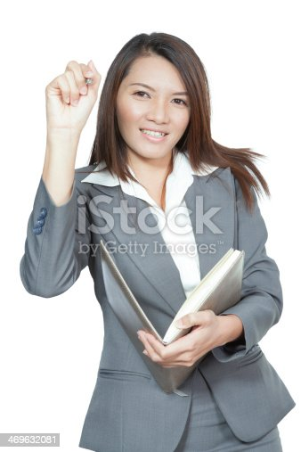 Happy smiling cheerful attractive young business woman writing or drawing on screen with black marker, isolated on white background
