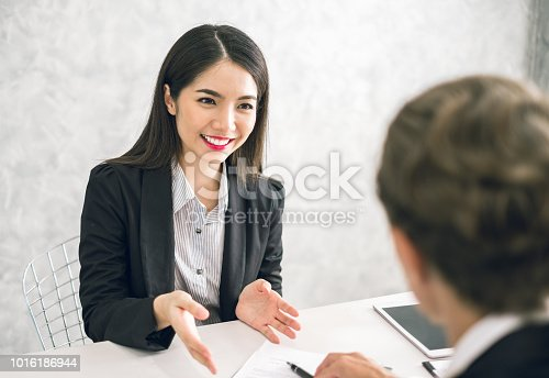 istock Asian business woman discussing/job interview with colleague/boss for business meeting 1016186944