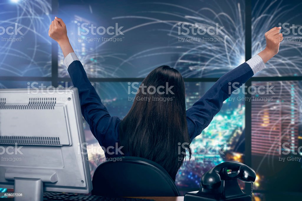 Asian business woman happy looking window because this is new stock photo