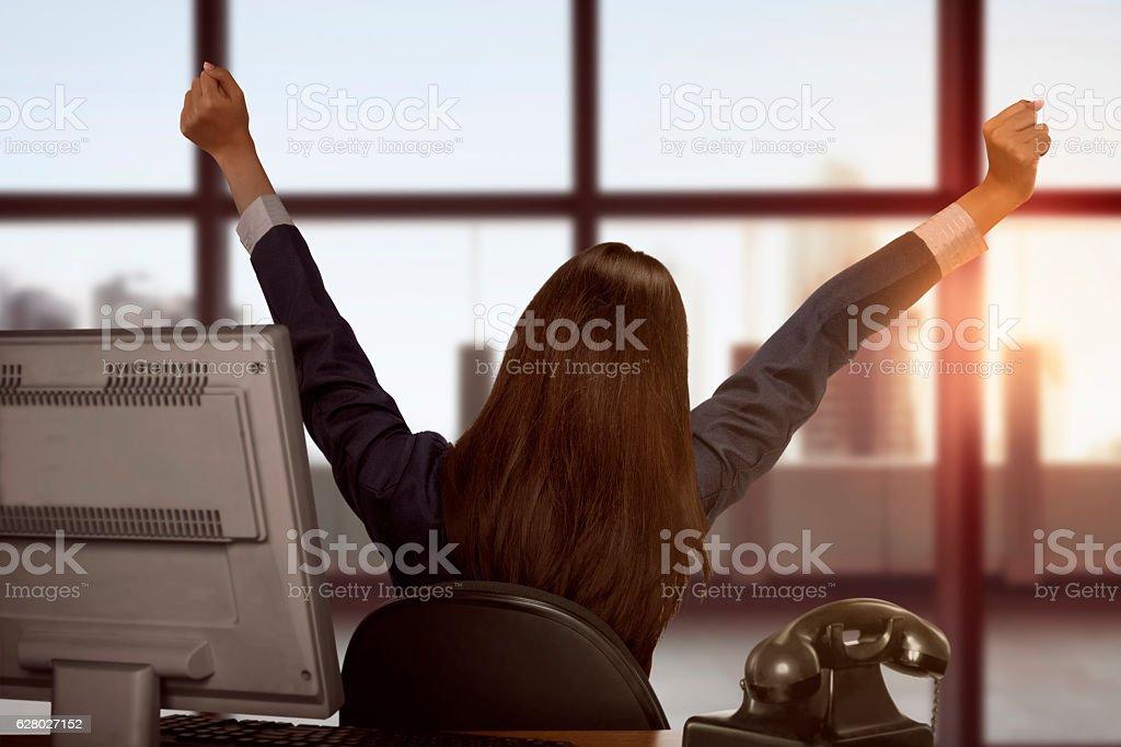 Asian business woman happy looking window stock photo