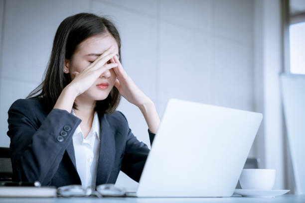 Asian business woman headache stressed because of work mistake problems about profit losses to be risk for fired from her job Asian business woman headache stressed because of work mistake problems about profit losses to be risk for fired from her job overworked stock pictures, royalty-free photos & images