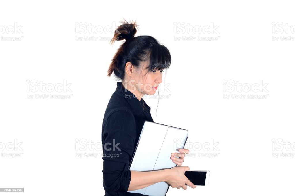 Asian business woman holding laptop and smartphone isolate on white background royalty-free stock photo