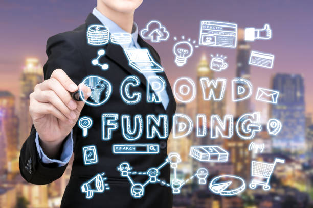 Asian business woman is writing crowdfunding idea concept stock photo