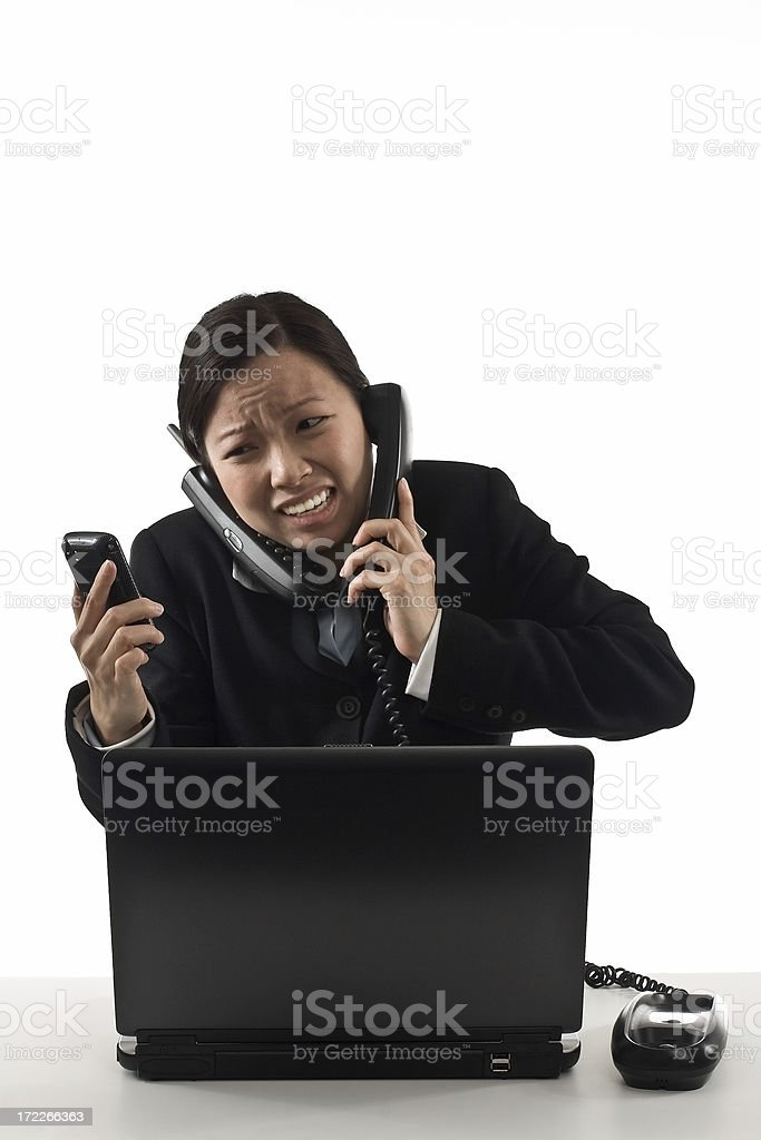 Asian business woman multitasked and stressed stock photo
