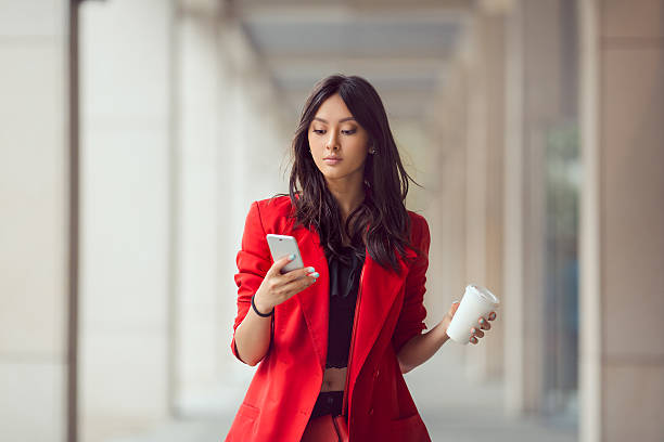 Asian business woman outdoors stock photo