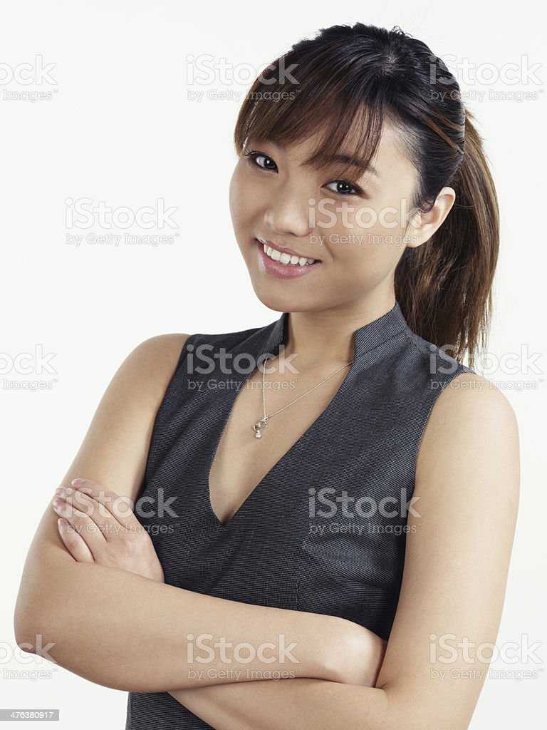Asian business woman portrait arms crossed stock photo