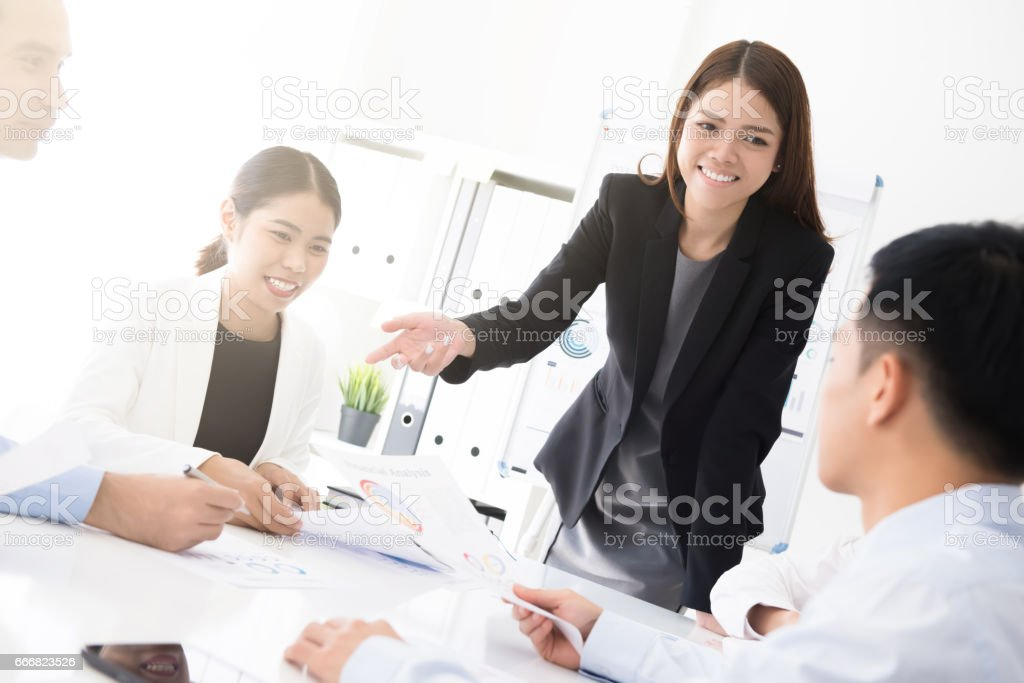 Asian business woman presenting her work stock photo