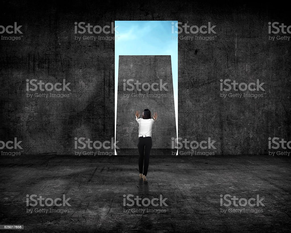Asian business woman push wall stock photo