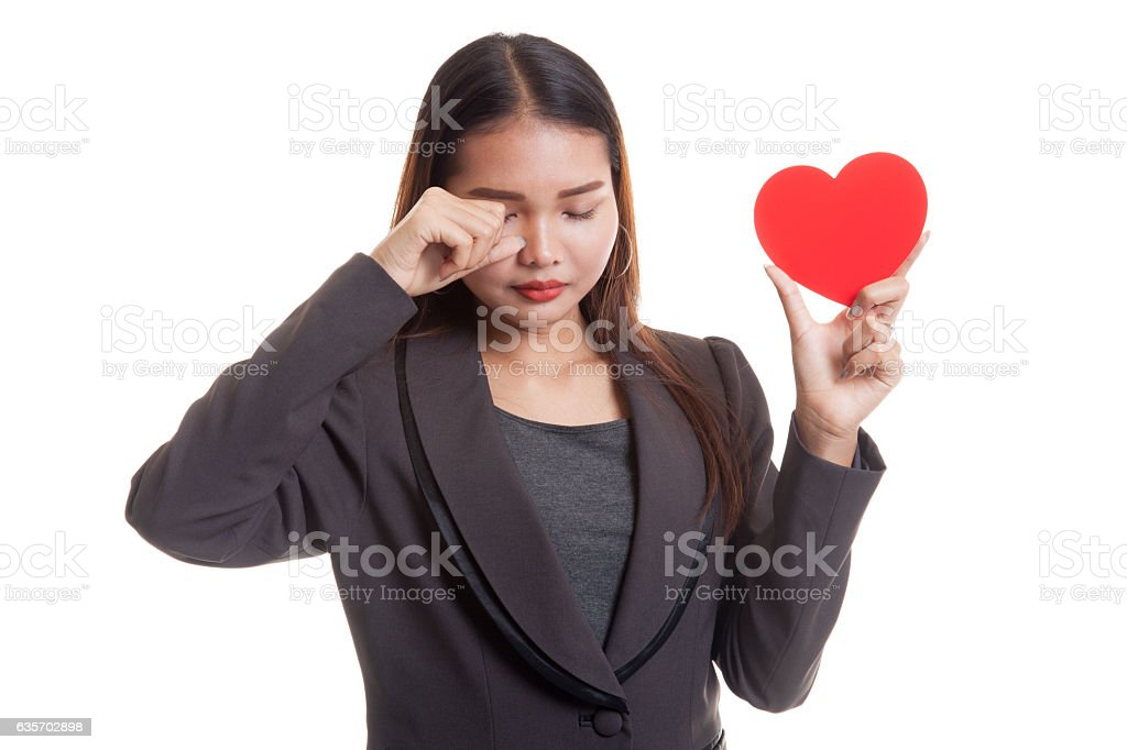 Asian business woman sad and cry with red heart. royalty-free stock photo