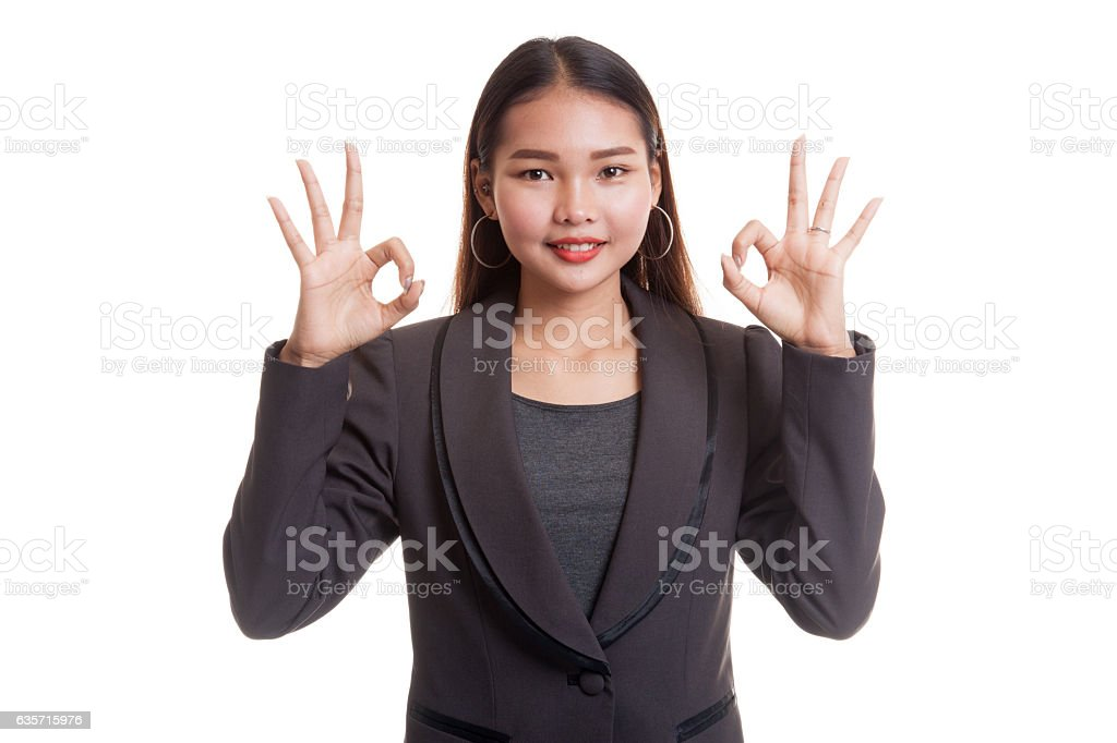 Asian business woman show double OK hand sign  and royalty-free stock photo
