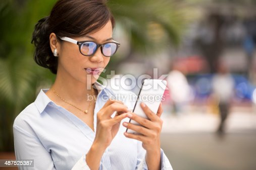 istock Asian Business Woman Smart Phone 487525387