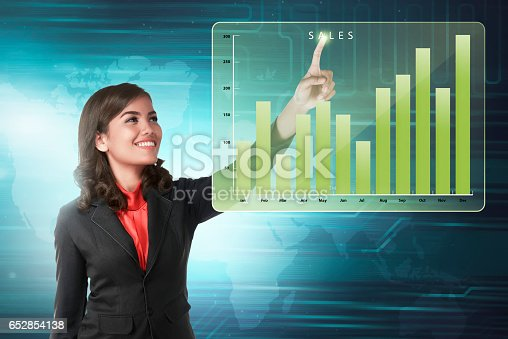 istock Asian business woman touching marketing sales income chart 652854138