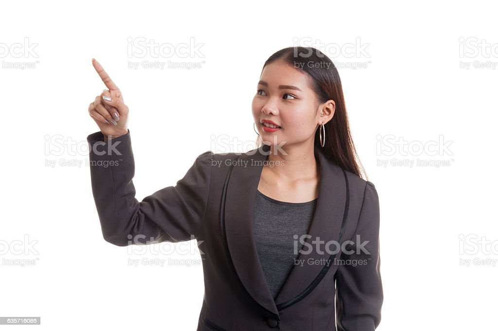 Asian business woman touching the screen with her finger. royalty-free stock photo