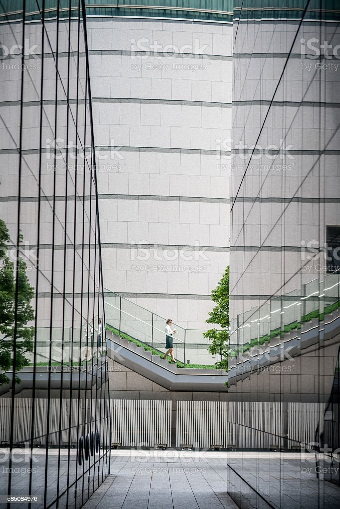 Asian business woman walking in a financial district stock photo