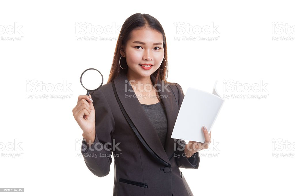 Asian business woman with a book and magnifying glass. royalty-free stock photo